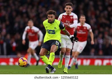 Daniel Williams of Huddersfield Town shields the ball from Lucas Torreira of Arsenal - Arsenal v Huddersfield Town, Premier League, Emirates Stadium, London (Holloway) - 8th December 2018