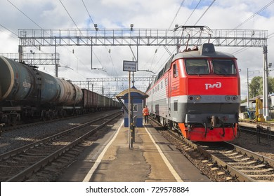 Danilov, Yaroslavl Region, Russia - July 25, 2017: Long-distance passenger train with electric locomotive CHS7-276 at the platform of the railway station Danilov Yaroslavl region