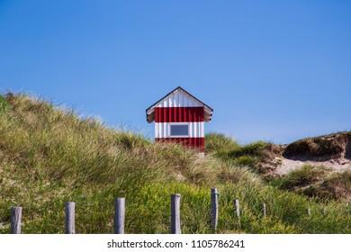 Danish beach cabin on seaside beach, danish landscape