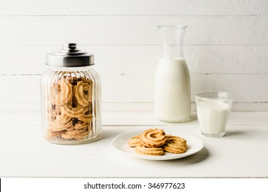 Danish butter cookies with fresh milk on wood table, Still life with cookies and milk
