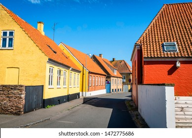 Danish city streets with colorful buildings on the island of Bornholm in the summer