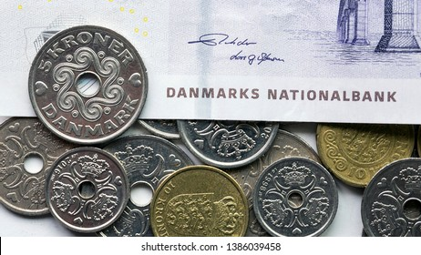 Danish coin over a fifty krone noteThe krone is the official currency of Denmark, Greenland, and the Faroe Islands, introduced on 1 January 1875.