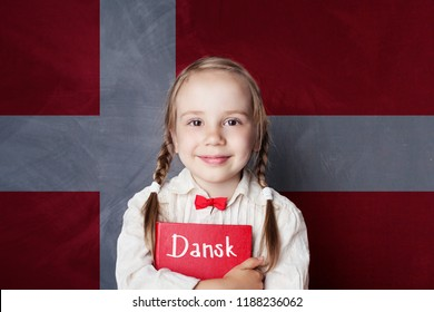 Danish concept. Child girl student with book against the Danish flag background. Learn language