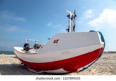 Danish fishing boat with danish flag, Danish beach landscape