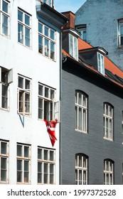 Danish flag in window in old apartment in Copenhagen