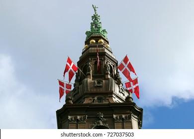 Danish flags at Christiansborg Castle. Copenhagen. Denmark. Europe.