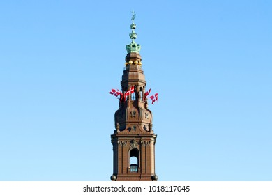 The danish flags on the tower. Christiansborg Palace, Copenhagen, Denmark.