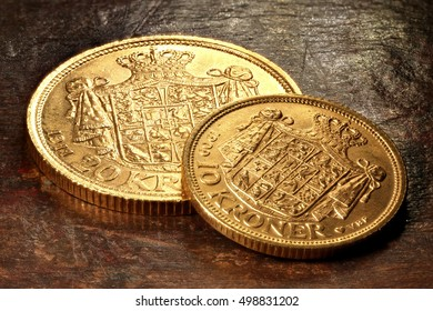 Danish gold coins on rustic wooden background