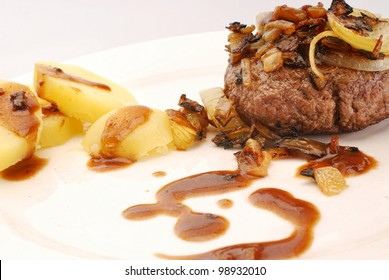 Danish homemade burgers with potatoes,onion and barbeque sauce, also known as hakkeboef med loeg