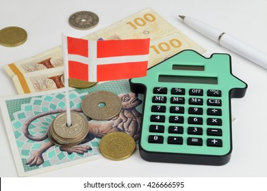 Danish notes and coins, with a house shaped calculator to represent property finance.