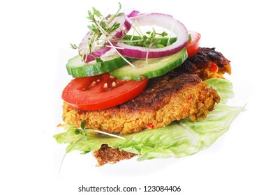 danish open faced sandwich or smoerrebroed with carrot patties, otherwise known as vegetarian frikadelles.