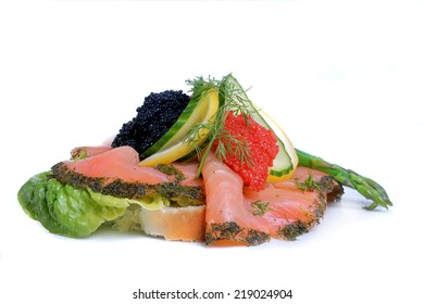 Danish open faced sandwich of  smoked salmon and seaweed  caviar on white bread. Also known as smorrebrod.