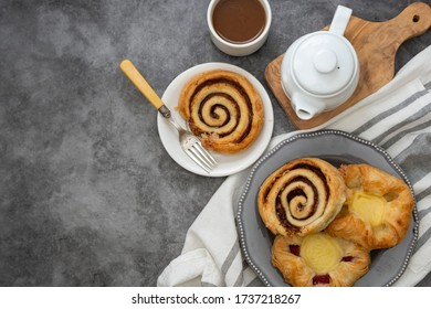Danish pastry with coffee cup for breakfast. Cinnamon rools buns.