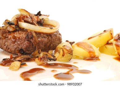 Danish traditional homemade burger with gravy, potatoes and onions, also known as boef med bloede loeg