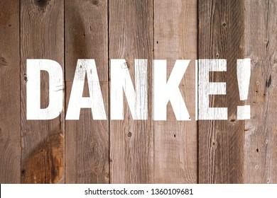 DANKE! character on wooden board