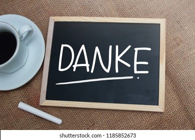 Danke, German thank you words letter, written on blackboard. Motivational business typography quotes concept