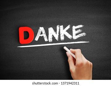 Danke (thank you in german) text on blackboard, concept background