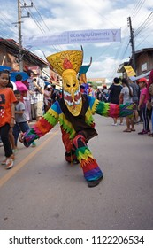 Dansai , LOEI /THAILAND - June 16,2018: Phi Ta Khon Festival sometimes known as Ghost Festival.Young people (Unidentified) dress in spirit and wear a mask, sing and dance.