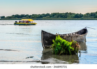 "DANUBE DELTA, ROMANIA - 16 OCTOBER, 2015: Danube Delta ""Delta Dunarii"" Romania, Group of tourists visiting the Danube Delta."