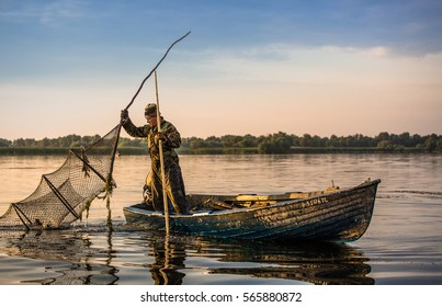 Danube Delta, Romania, August 14, 2016: traditional fishing method practiced in the Danube Delta by the fishermen with nets fixed to wooden stocks in the water.