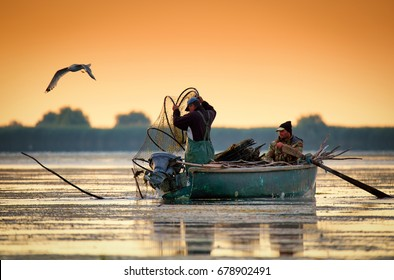 Danube Delta, Romania, June 2017: fishermans checking nests at sunrise in Danube Delta