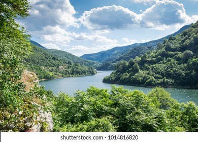The Danube river flowing through the mountains on a sunny day. Danube Boilers, Romania