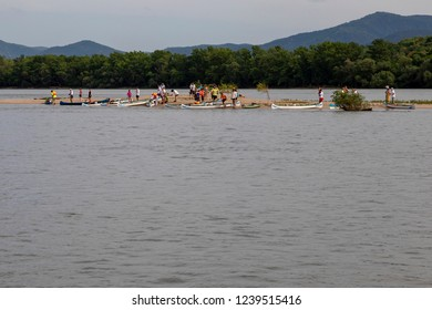 Danube River Hungary 4 30 2018:  Group of tourist kayaking on the Danube river. , taking a short rest on a sandy island.