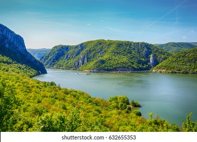 Danube river landscape, Serbia and Romania border ,narrowest part of the gorge on the Danube , also known as the Iron Gate. Beautiful blue sky at spring day.