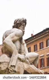 Danube river statue - detail of the Fountain of the Four Rivers (Fontana dei Quattro Fiumi) by architect Bernini on Piazza Navona. Rome, Italy.