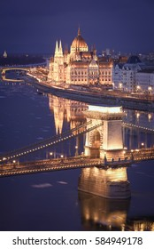 Danube river view reflection of Budapest parliament and chain bridge during night