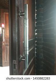 Danurejo, Mertoyudan, Indonesia - juli 13, 2019: wooden door handles of stainless steel material