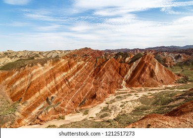 Danxia Feng, or Colored Rainbow Mountains, in Zhangye, Gansu, China. Here the view from the Colorful Embroidered observation deck