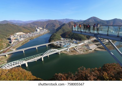 DANYANG, SOUTH KOREA : OCTOBER 31, 2017 - Tourists on the observation platform of Mancheonha Skywalk tower. The tower is one of the popular tourist stops in Danyang County in South Korea.