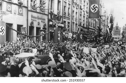 Danzig (Gdansk) greets the Fuhrer on Sept. 19, 1939. German Chancellor, Adolf Hitler receives Nazi Salutes as his rides in victory through Danzig.