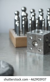 DAPPING PUNCH set used for shape metal into a variety of dome sizes. Low depth of field dapping punches and block with copy space in hipster style. dapping punch and dapping block.