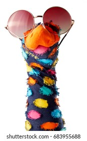 Dappled colorful sock puppet with sunglasses isolated on white background