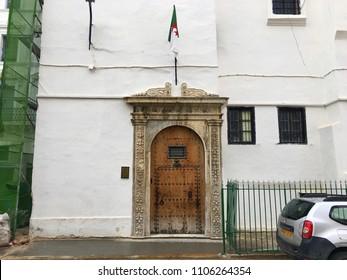 Dar Aziza, Algiers, Algeria - March 30, 2018: Entrance door of Dar Aziza with Algerian flag.