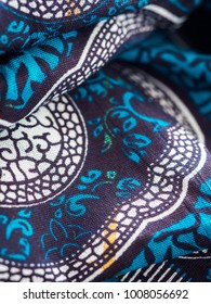 DAR ES SALAAM - JANUARY 19, 2018: Colourful African fabric form Tanzania, close up.