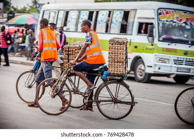 Dar es Salaam, Tanzania, Africa, circa May 2013.  An unidentified man rides a bicycle in Dar es Salaam.  The city has major infrastructural problems, including an outdated transportation system.