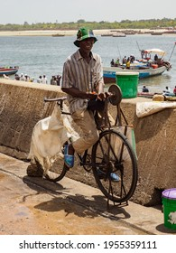 Dar es Salaam, Tanzania - Feb, 2021: The bicycle is a very popular means of transport in Africa, both for transporting people and various types of goods. Kivukoni Fish Market. Covid time in Africa.