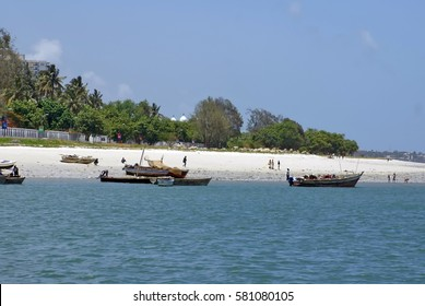 DAR ES SALAAM, TANZANIA - JANUARY 3, 2014: Beach and coast at the side of the capital city, seen from the ferry to Zanzibar