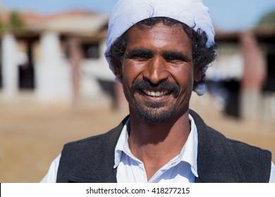 DARAW, EGYPT - FEBRUARY 6, 2016: Portrait of local camel salesman with turban.