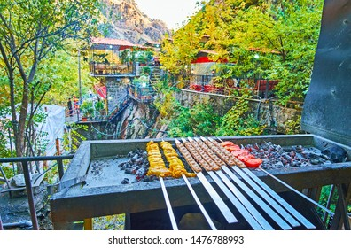 Darband restaurants offer traditional bbq (mangal) dishes, such as shishlik -pickled meat on skewers and kabob koobideh - kebab dish of lamb or beaf, Tehran, Iran