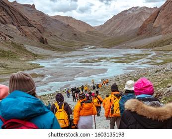 Darchen , Tibet China - August 19 2019: Pilgrims embarking on a sacred pilgrimage around Mt Kailash