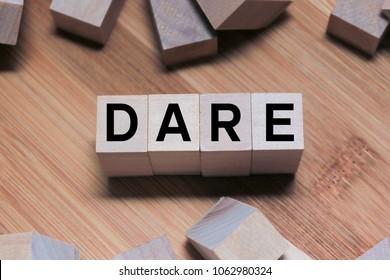 DARE Word Written In Wooden Cube