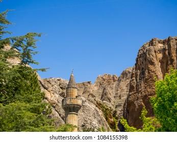 Darende Malatya, Turkey Somuncu father's tomb. Minaret, trees and blue sky.