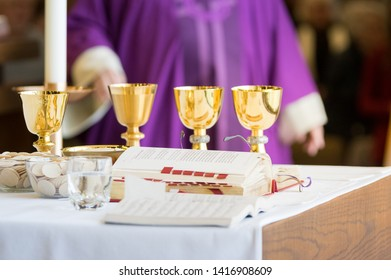 Darien, IL / USA - June 2019: Preparation of Gifts Host Altar Chalice Wine Bread Body of Christ Eucharist Mass