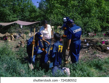 Darien Illinois, USA, 9th June,1988 Authorities say that they have discovered a burial ground once used by the mob in a Du Page County field FBI agents check soil probe for evidence of human remains