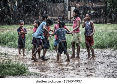Darien/Panama/September2018  Indigenous kids are playing outside in the rain. This Tribe lives in the rainforest south of Panama on the border to Colombia. There is no electricity or running water