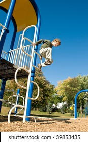 daring boy leaps from play structure